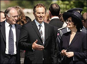 Conservative leader Michael Howard and Cherie Blair listen to the prime minister