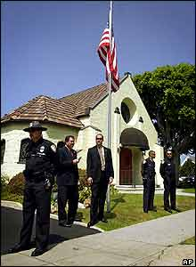 Secret service agents and uniformed police officers stand watch at the Santa Monica funeral home.