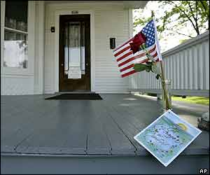 A flower, flag and sympathy card sit on the porch of former President Ronald Reagan's childhood home in Dixon, Illinois