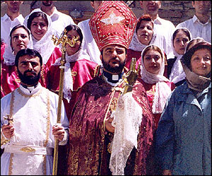 Armenian Orthodox priest and followers assemble on steps of church in the West Azerbaijan region of Iran.
