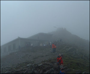 Snowdon cafe in the mist and the crowds on the summit (Philip Coleman)
