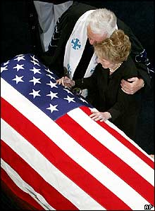 Rev Michael Wenning comforts Nancy Reagan by her husband's coffin