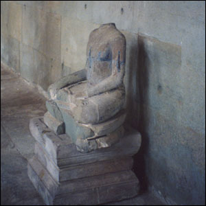 Statue at Angkor with its head missing