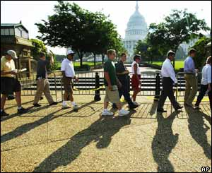 People follow each other in line to go into the Capitol Building.