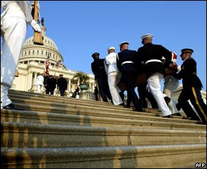 The casket of former President Ronald Reagan is carried up the steps of the United States Capitol by a military honour