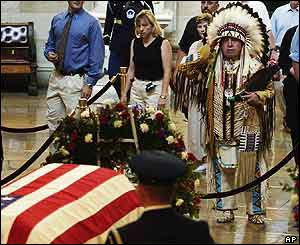 A native American salutes the casket of former President Ronald Reagan