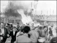 Spectators fleeing from the fire caused by the crash