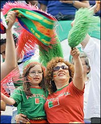 Fans of all ages enjoy the spectacle at the opening ceremony for Euro 2004