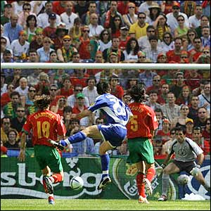 Portugal fail to close down the advancing midfielder and pay the price as he gets the first goal of Euro 2004
