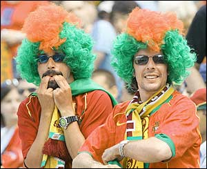Prtugal fans wear wigs at the match with Greece