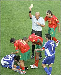 Referee Pierluigi Collina books Portugal's Costinha