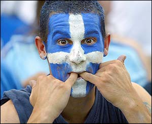 A Greece fan whistles during his side's match with Portugal