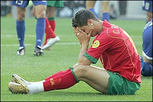 Ronaldo holds his head in his hands after conceding a penalty