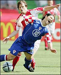 Johann Vogel of Switzerland clashes with Niko Kovac of Croatia in the first Group B match