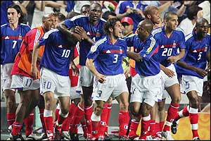 France congratulate Zinedine Zidane after he gives them victory over England in their first game of the competition