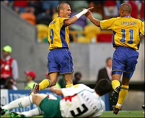 Ljungberg celebrates with team-mate Henrik Larsson
