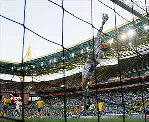 Andreas Isaksson of Sweden tips a shot over the bar