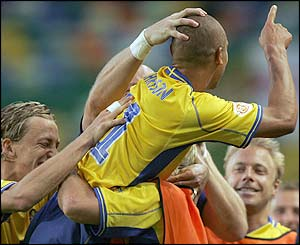 Henrik Larsson celebrates stretching Sweden's lead to 2-0