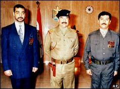 Uday and Qusay Hussein with their father