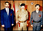 Uday and Qusay Hussein with their father (copyright: AP)