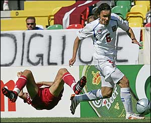 Czech Republic defender Marek Jankulovski breaks a tackle by Latvia's Verpakovskis