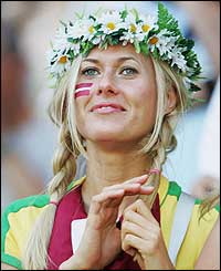 A Latvian fan enjoys her team's unexpected half-time lead