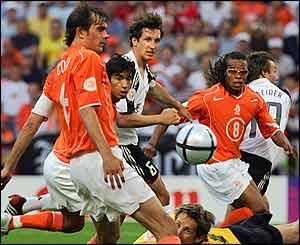 Dutch defenders watch the ball approach their goal from Torsten Frings' free-kick