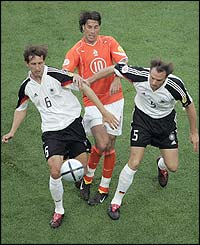 Rudd van Nistelrooy tries to find a way through the German defence