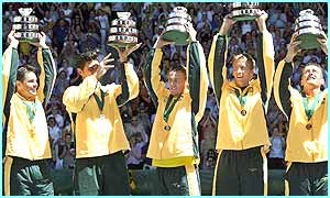 The Australian team hold up their trophies