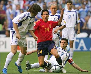 Spain's midfielder Vicente is tackled