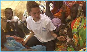 Film star Angelina Jolie working for the United Nations handing out food