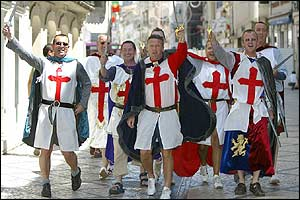 England fans walk through the centre of Coimbra in Portugal before England's match with Switzerland