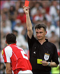 Russian referee Valentin Ivanov shows the red card to Bernt Haas