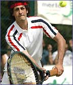 John McEnroe - or is it Alistair MacGowan? - uses a large racket