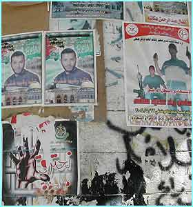 Posters of Palestinians on a wall in Nablus.  They show men who've died during the troubles including suicide bombers.