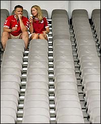 Two Denmark fans enjoy some refreshments in the Braga Municipal stadium as kick-off against Bulgaria approaches