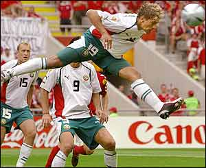 Bulgaria's midfielder Stilian Petrov heads the ball