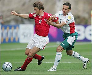 Denmark's Thomas Helveg is challenged by Martin Petrov