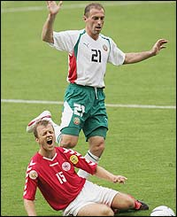 Zoran Yankovich of Bulgaria clashes with Daniel Jensen