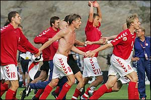 Danish players celebrate a 2-0 win that dumps Bulgaria out of the tournament,