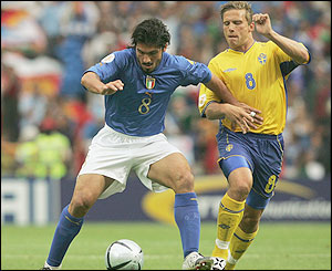 Italy's Gennaro Gattuso holds off Anders Svensson