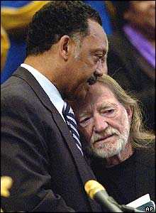 Willie Nelson embraced by the Reverend Jesse Jackson