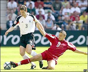 Maris Verpakovskis challenges German defender Arne Friedrich