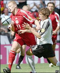 Latvia and Germany players tussle for the ball in the opening period