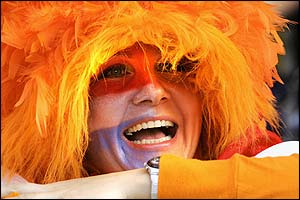 A Dutch fan enjoys the atmopshere at the Aveiro Municipal stadium as kick-off approaches against the Czech Republic