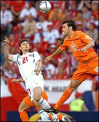 Czech Republic's midfielder Tomas Rosicky battles with Ruud van Nistelrooy