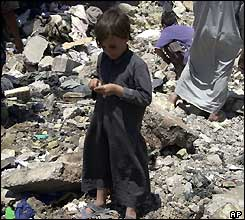 Child in the ruins of a house after Falluja attack