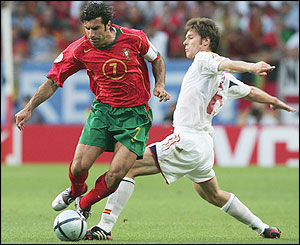 Xabi Alonso tackles Luis Figo