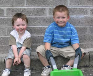 Leanne Brain's son Morgan Brain and nephew Tomas Skelding looking worn out and dirty after helping in the garden