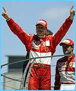 Michael Schumacher celebrates his win